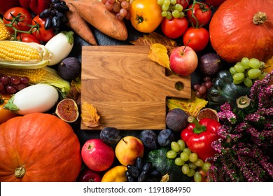 Healthy food background with autumnal vegetables and fruits. Autumn fruits vegetables and leaves set. Thanksgiving day concept. Top view with copy space