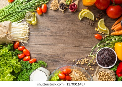 Healthy food background ,fruits and vegetables with salad bowl on wooden table.