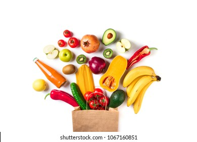 Healthy food background. Healthy food in paper bag pasta, vegetables and fruits on white. Shopping vegetarian food supermarket concept. Top view
