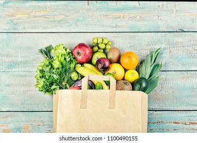 Healthy food background. Paper bag with healthy food. Grocery shopping concept, top view, copy space
