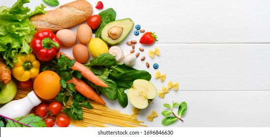 Healthy food background. Food photography different fruits and vegetables on white wooden table background. Copy space. Shopping food in supermarket - Shutterstock ID 1696846630
