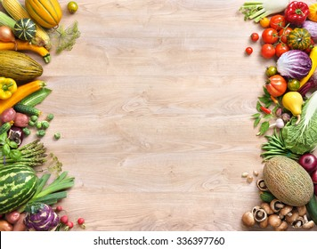 Healthy food background / studio photo of different fruits and vegetables on old wooden table. Copy spacy for your text. High resolution product