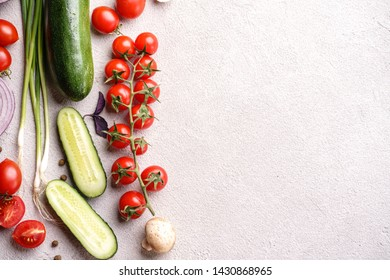 Healthy food background. Summer vegetables and herbs on white. Shopping food gastronomy concept. Layout with copy space