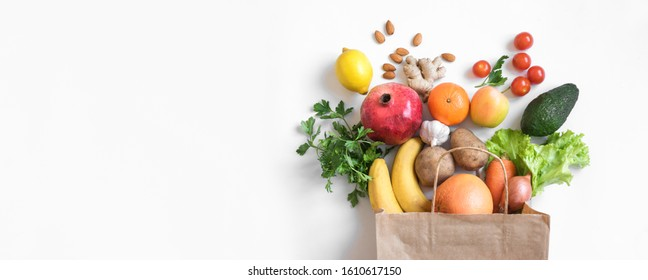 Healthy food background. Healthy vegan vegetarian food in paper bag vegetables and fruits on white, copy space, banner. Shopping food supermarket and clean vegan eating concept. - Shutterstock ID 1610617150