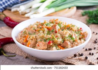 Healthy food. Barley porridge with meat and vegetables.