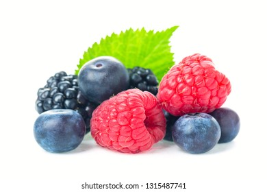 Healthy food berries set. Macro shot of fresh raspberries, blueberries and blackberries with leaf isolated on white background.