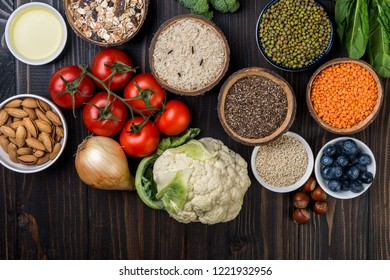 Healthy food,  berries, vegetables, seeds, superfood, cereals on wooden background top  view