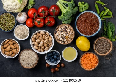 Healthy food,  berries, vegetables, seeds, superfood, cereals on gray background top  view
