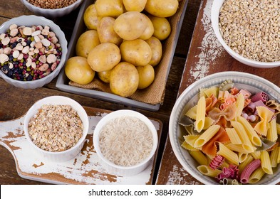 Healthy Food: Best Sources of Carbs on wooden table. Top view