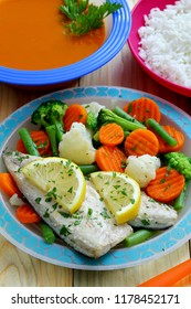 healthy food boiled fish on kitchen table background
