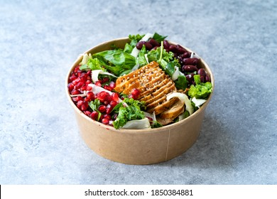 Healthy Food Bowl with Pomegranate, Chicken, Mexican Kidney Beans and Salad in Plastic Bowl Container. - Shutterstock ID 1850384881