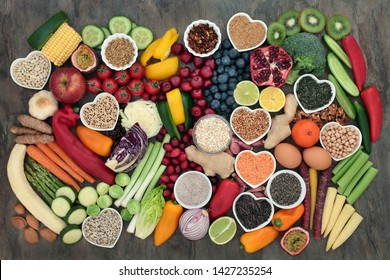 Healthy food choice with super food of fruit, vegetables, seeds, legumes, cereal, grains, nuts, herbs and spices. High in antioxidants, anthocyanins, protein, vitamins and dietary fibre. Flat lay.
