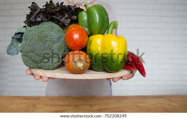 Healthy food and clean concept, hands doctor with vegetables