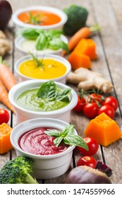 Healthy food, clean eating concept. Variety of colorful seasonal fall vegetables creamy soups with ingredients. Pumpkin, broccoli, carrot, beetroot, potato, tomato spinach
