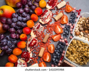 Healthy food clean eating selection: fruits,, superfood, nuts on gray concrete background