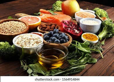 Healthy food clean eating selection: fish, fruit, vegetable, cereal, leaf vegetable on background - Shutterstock ID 1564914844