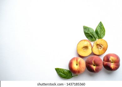 Healthy food, clean eating, summertime background. Fruit layout made of sweet ripe peaches on white