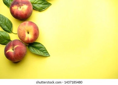 Healthy food, clean eating, summertime background. Fruit layout made of sweet ripe peaches on yellow table