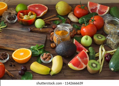 Healthy food, clean food selection:  fruits, vegetables, seeds, spices on wooden background