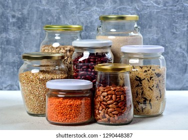 Healthy food concept. Collection of grain products in storage jars in pantry.