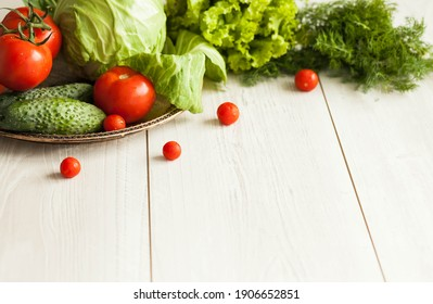 Healthy food concept. Fresh vegetables on a white wooden background. Healthy eating. View from above. Copy space.