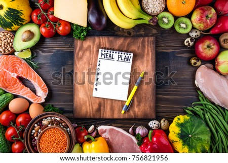 Healthy food concept. Fresh  vegetables, fruits, meat and fish on wooden table. Healthy eating and meal plan. Top view
