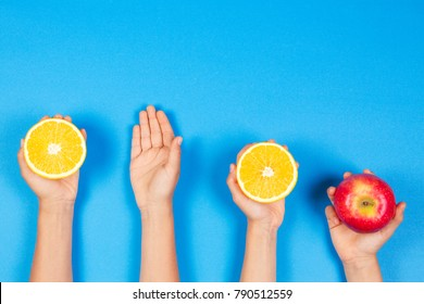 Healthy food concept. Many kids hands with fuits. Top view