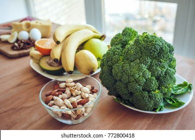 Healthy food concept. Meat, fish, fruits, vegetables, nuts, milk are lying on the table.
