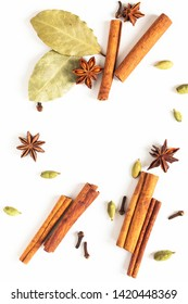 Healthy food concept Mix of organic spices star anise, cinnamon, bay and cardamom pods on white background