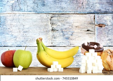 Healthy food concept, presentation of sugar content in fruits and sweets with stacks of cubic sugar