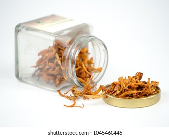 Healthy food Cordyceps Mushroom in a glass bottle dry for soup on white background. (selective focus)