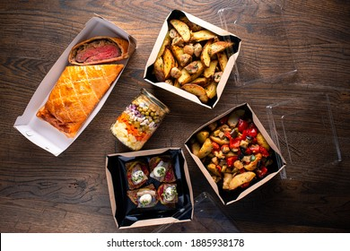 Healthy food delivery. Take away vegetables, meat in boxes. Top view, flat lay with copy space. delivery of ready-made food in boxes for festive table top view