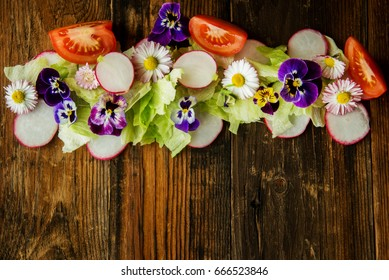 Healthy food. Detox. Organic nutrition. Salad leaves with herbs and flowers. edible flowers