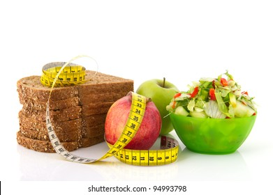 Healthy food for diet as bread fruit and vegetables with measurement tape