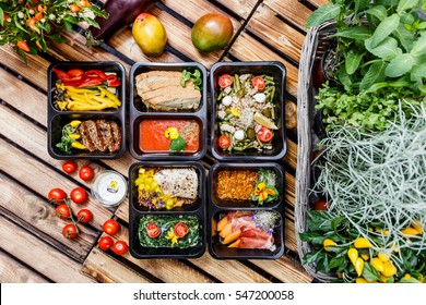Healthy food and diet concept, restaurant dish delivery. Take away of fitness meal. Weight loss nutrition in foil boxes.