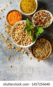 Healthy food, dieting, nutrition concept, vegan protein source. Raw of legumes (chickpeas, red lentils, canadian lentils, beans, bulgur, chickpea). Top view flat lay.