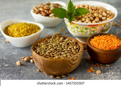 Healthy food, dieting, nutrition concept, vegan protein source. Raw of legumes (chickpeas, red lentils, canadian lentils, beans, bulgur, chickpea).