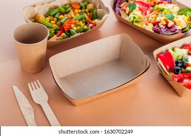 Healthy food in disposable eco friendly food packaging. Empty brown kraft paper food container on beige background.