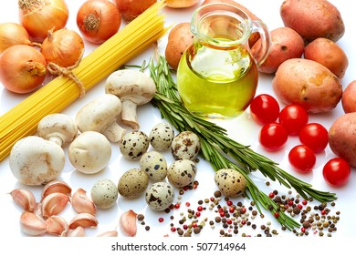 Healthy food & drink cooking concept: Fresh Italian food pasta vegetables herbs & spices Home food. Garlic mushrooms onion pepper potato rosemary & olive oil. White background Top view