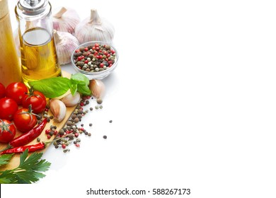 Healthy Food & drink diet Italian lifestyle: Mediterranean vegetable herbs spice healthy cuisine. Olive oil tomatoes garlic parsley basil. Top view Isolated on white Free space text layout