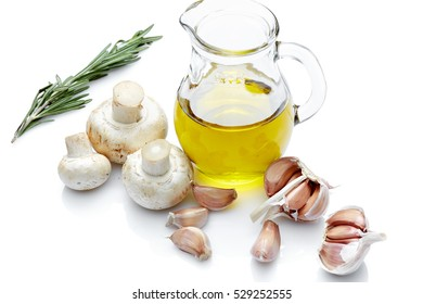 Healthy food & drink Italian healthy lifestyle: Mediterranean fresh vegetables mushrooms spices & Italian herbs: Mushrooms Olive Oil, garlic & rosemary. Top view Isolated on white