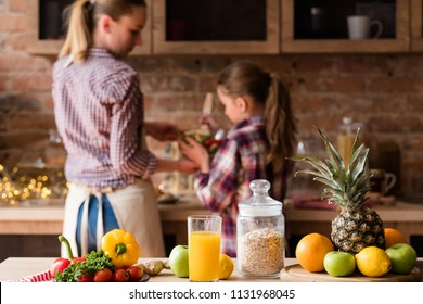 healthy food eating. organic natural vegetables fruit fresh orange juice and oatmeal. balanced nutrition. wholesome meal cooking.