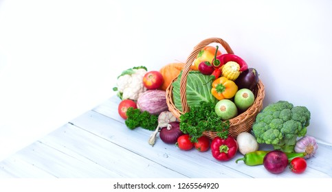 Healthy food. Farm products - basket of vegetables on blue wooden background.