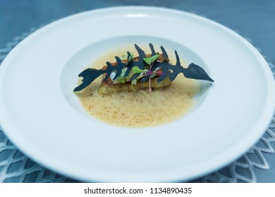 Healthy food with fish menu on white dish, in luxury restaurant.