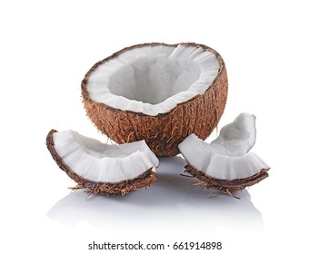 Healthy food. Fresh coconut with pieces isolated on white background