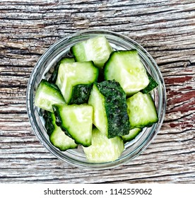 Healthy food. Fresh cucumbers are cut into pieces in a glass bowl. Natural products.top view
