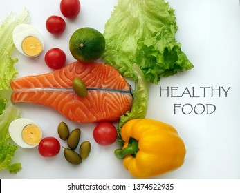 Healthy Food Fresh Fish  Raw Salmon Two  steaks with ingredients vegetables and spices  tomatoes  lemon and olives cucumber green salat onion garlic lime  Healthy food diet concept