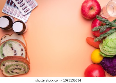 healthy food fruit and vegetable against junk food and supplementary medicine on orange background