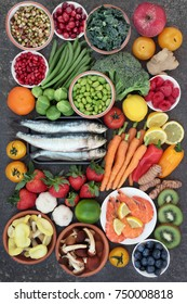 Healthy food for good health concept with super food of sardines, crevettes, fruit, vegetables, herbs and spice. Foods very high in antioxidants, anthocyanins, omega 3 fatty acids, fiber and vitamins.