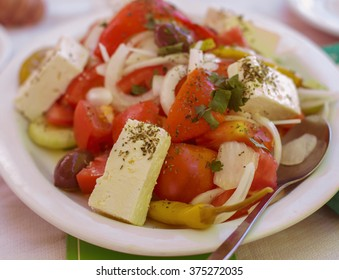Healthy Food Greek Salad, with tomato, onion , feta cheese.